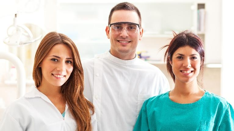 Group of smiling dental professionals l Dental Extractions in Allentown PA