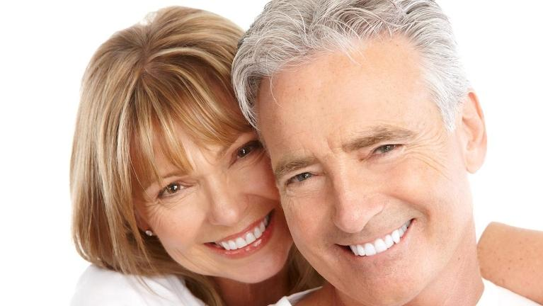 older white couple smiling l tooth repair allentown